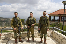 Israeli soldiers with rifles