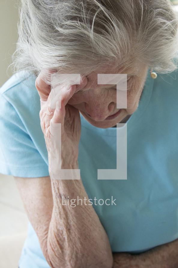 stressed elderly woman