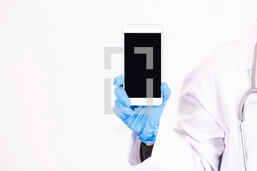 a doctor holding a blank cellphone screen.