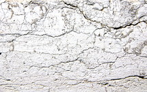 Cracked plaster on an ancient wall.