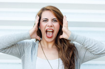 a young woman yelling an announcement