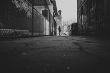 man standing in an alley in downtown NYC