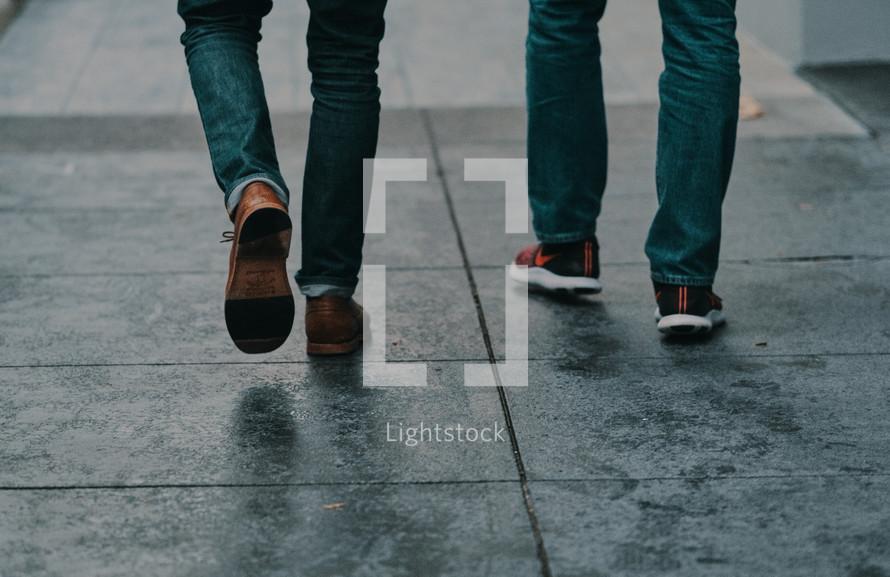 pedestrians walking on a sidewalk