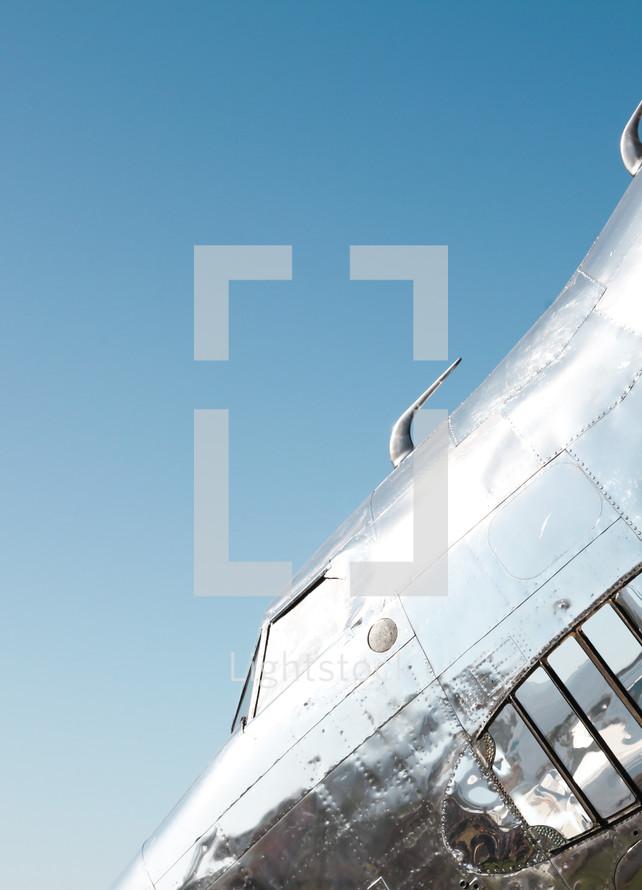 shiny silver plane