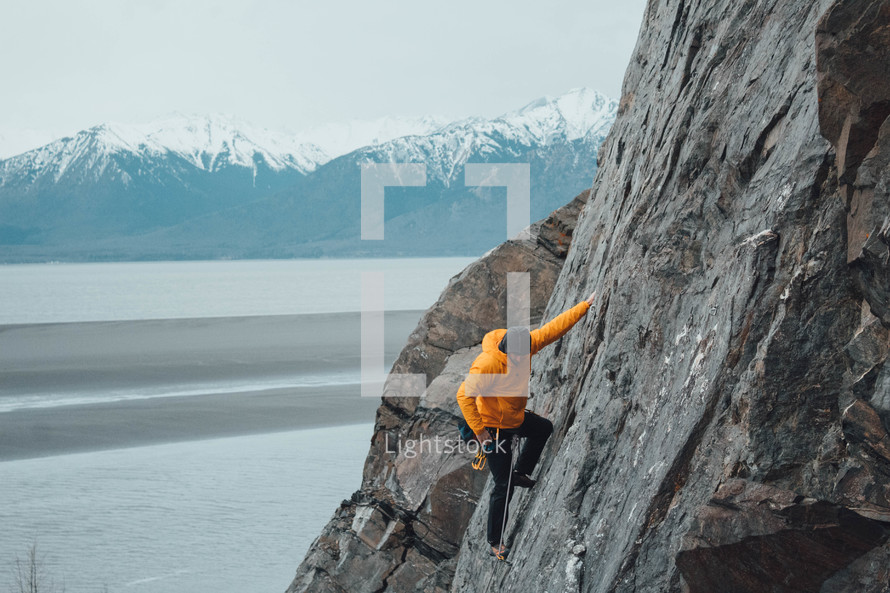 a man rock climbing