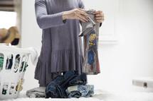 a woman folding laundry