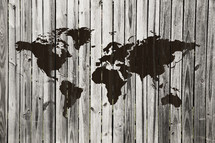 world map painted on an old wood fence.