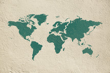 world map printed on a concrete wall.