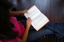 woman sitting reading a Bible