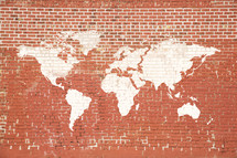 world map painted on an old brick wall.