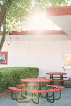 picnic tables in front of a burger joint