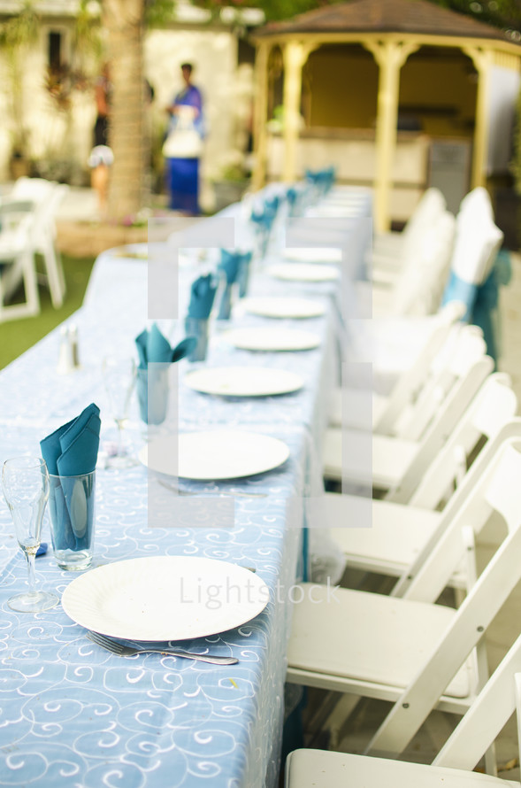 Outdoor wedding reception table and chairs.