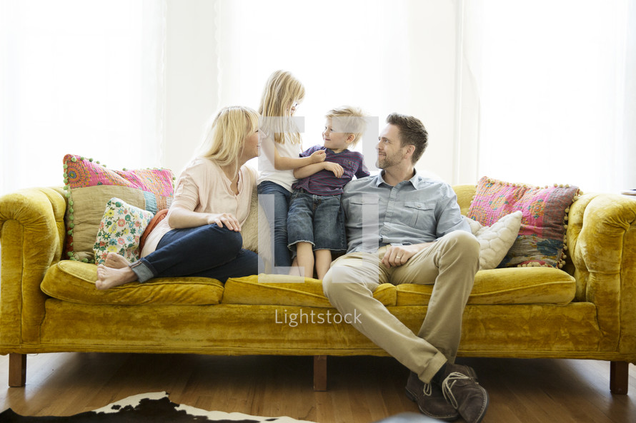 portrait of family sitting on a couch