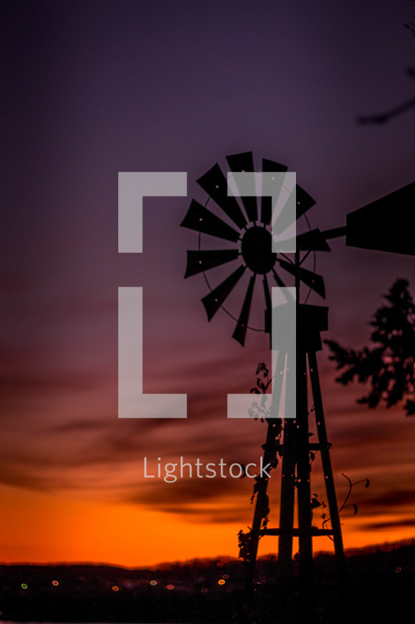 silhouette of a windmill