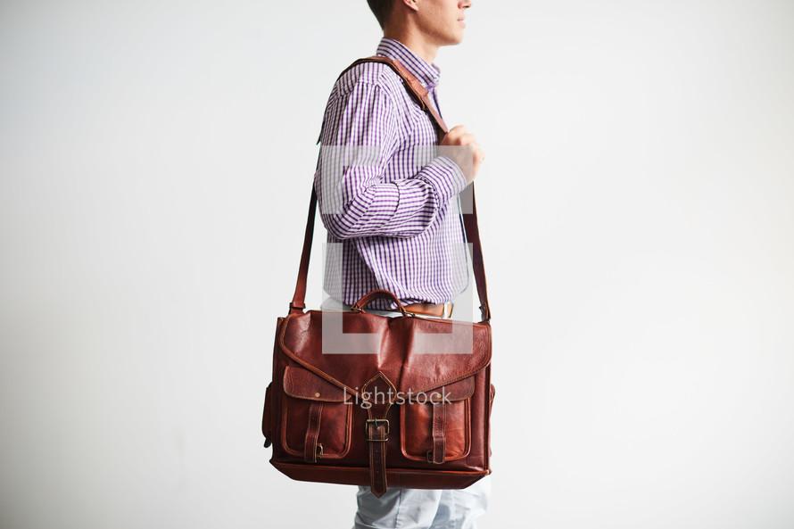 a man carrying a messenger bag