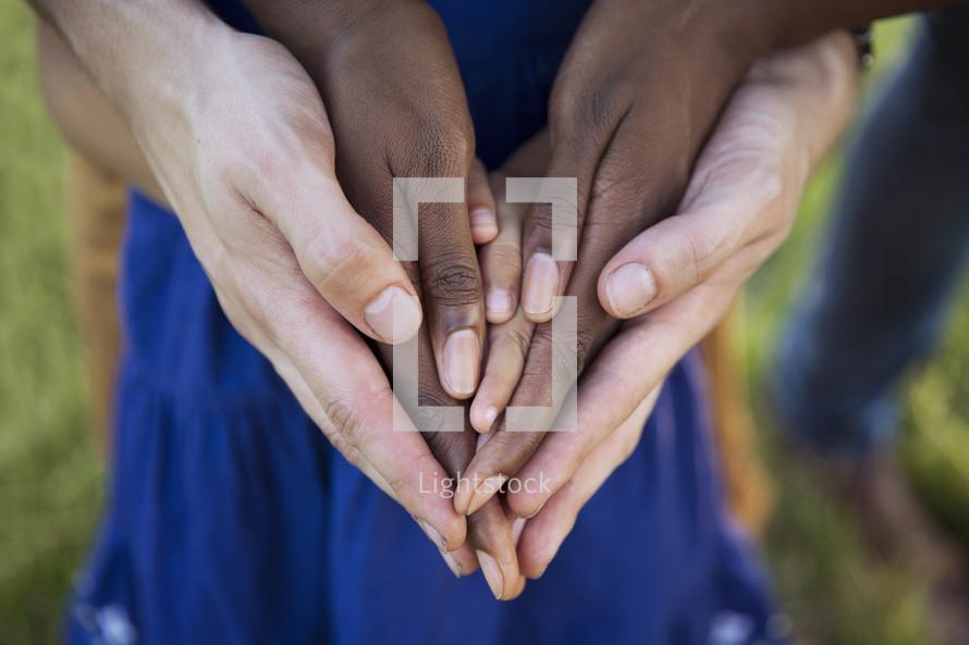 family's praying hands
