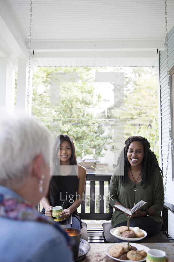 woman's group Bible study on a porch