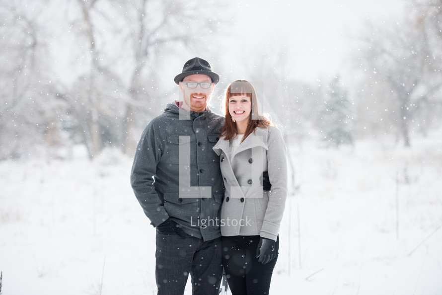 Couple standing, embracing, outside in the snow