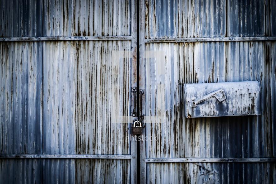 metal mailbox on a door