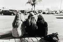 teenage girls sitting