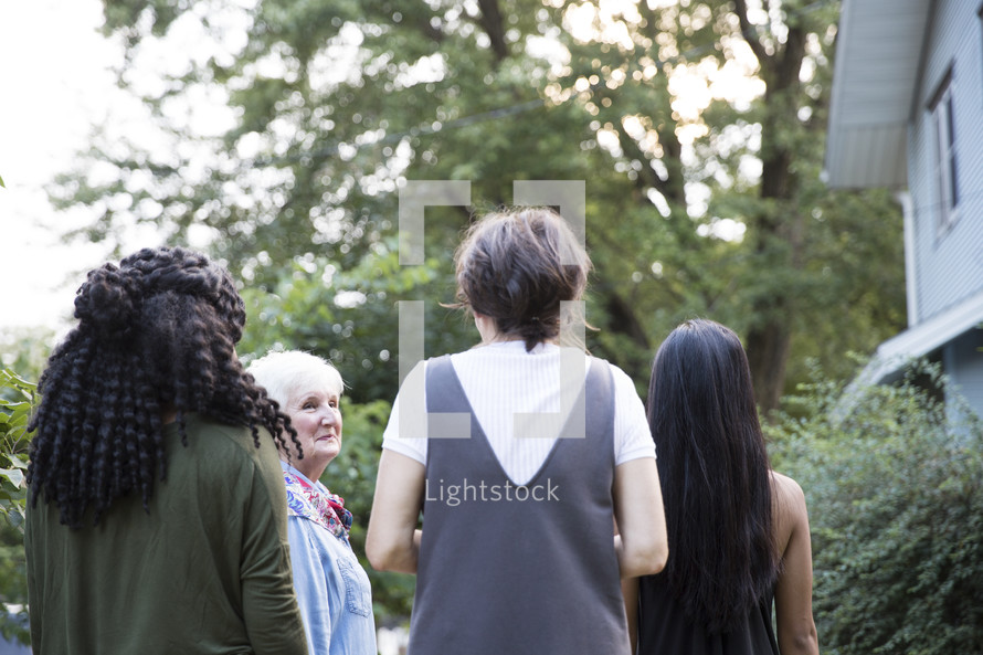 women standing together outdoors
