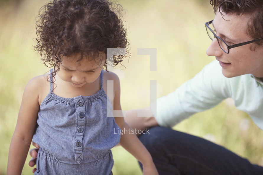 father lovingly consoling his daughter.