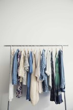clothes on hangers on a clothes rack