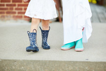 girls in dresses and rain boots