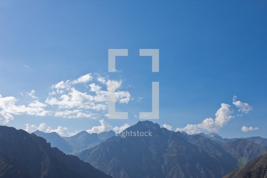 Mountain peaks against a blue sky.