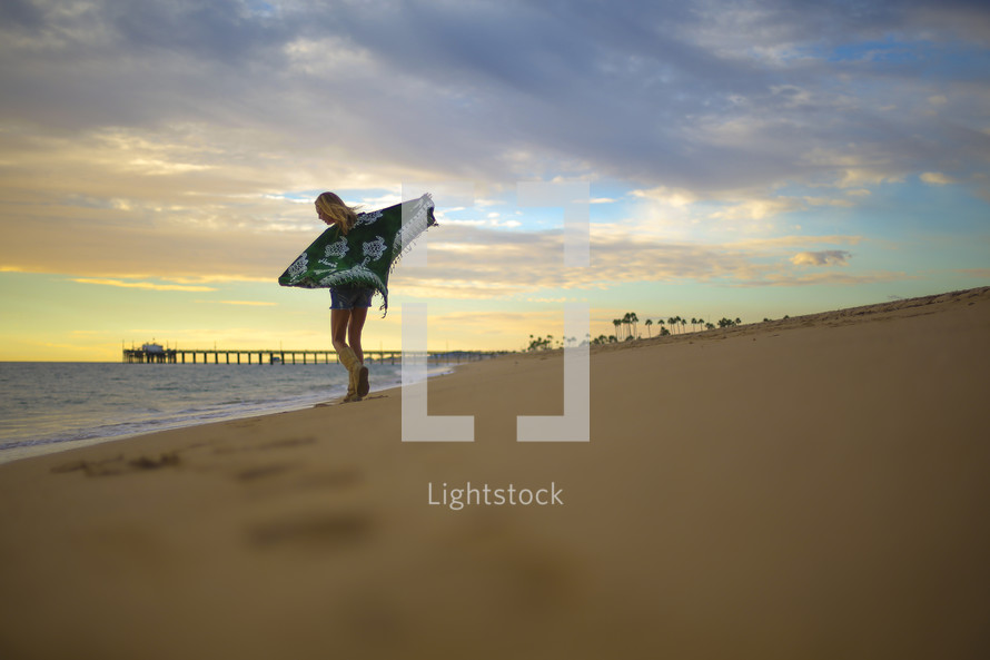 woman standing on a beach