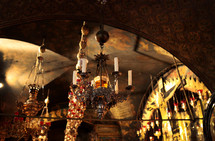 beaded chandeliers, ornate decoration within the Church of the Holy Sepulcher