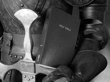 Bible held in a suit of armor.