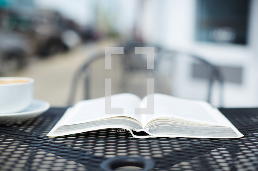 open Bible on an outdoor table