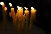 burning candles dripping wax