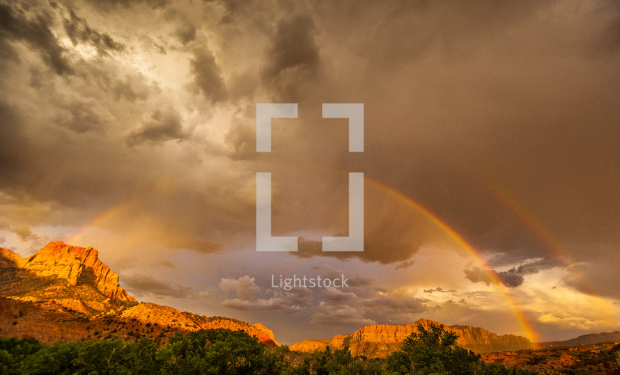 rainbow over red rock canyons