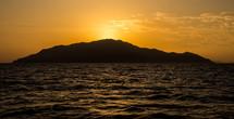 island and sea at sunset