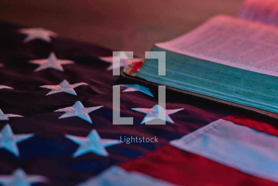 American flag next to a bible