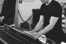a man behind a soundboard