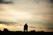 silhouette of a couple hugging