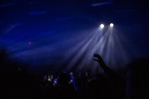 spotlights above an audience