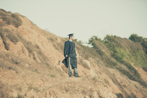 graduate on a cliff