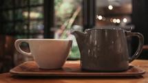 tea cup and tea pot