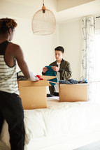 teen boys packing moving boxes