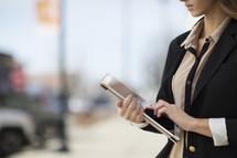 a career woman carrying an iPad