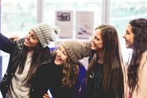 smiling teen girls in winter