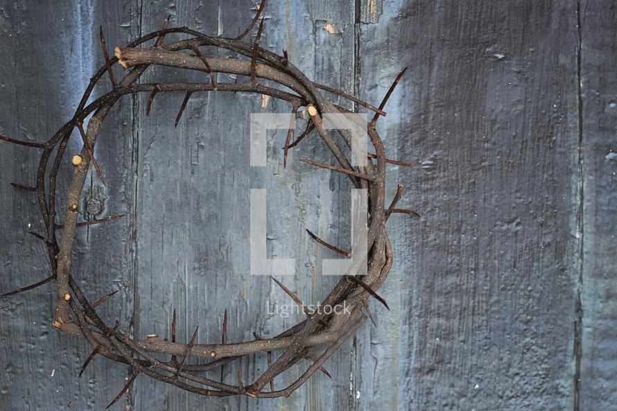 crown of thorns on wood