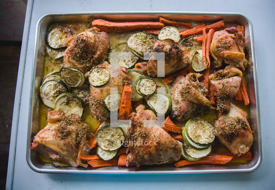 baked chicken and vegetables in a pan