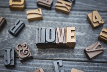 wooden print press stamps forming the word love