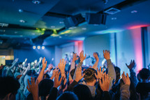 group worship - raised hands in an audience