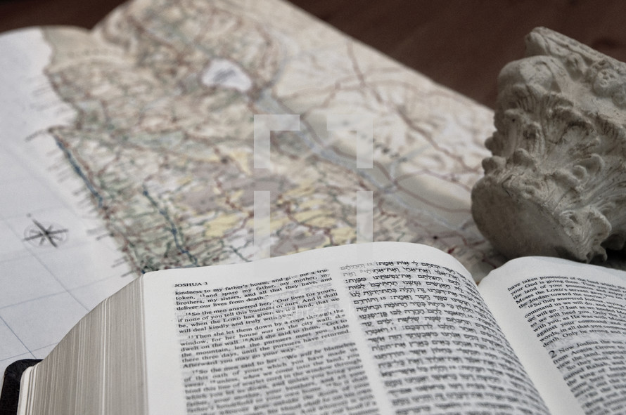 Hebrew - English Bible on top of a map of Israel.